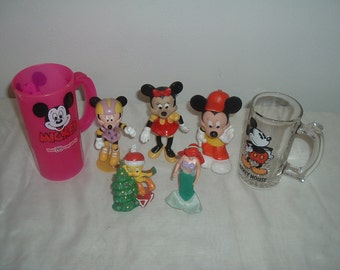 two disney glasses and five toys