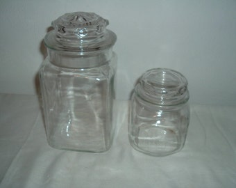 2 clear glass canisters