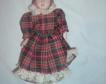 china head doll with an 1870's flat-top hairdo 8 inches tall plaid dress