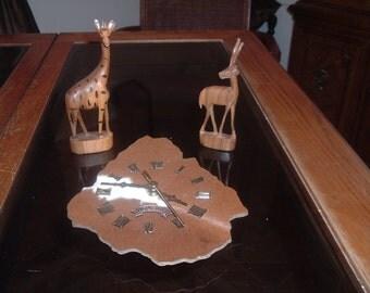 vintage cow hide  URUGUAV  clock and hand carved wooden animals