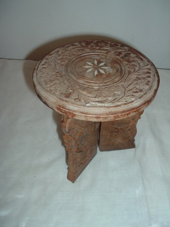hand carved 3 legged fold up table/ pot stand