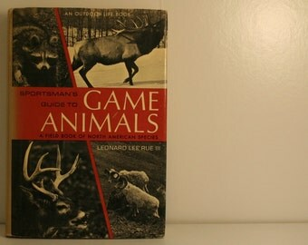 rust orange sportsman's guide to game animals book vintage