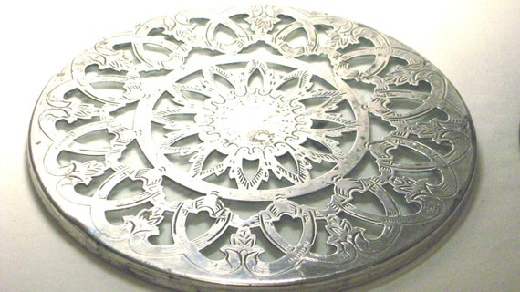 Sale...Nice little vintage silver plated rhodium trivet over glass in good condition