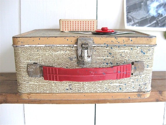 vintage metal lunch box with red button magnet.