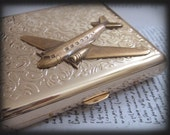 JOURNEY, gold airplane case for accessories