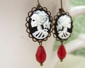 SKULL GODDESS antiqued brass earrings with resin cab and vintage red glass beads