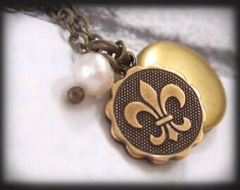 FLEUR DE LIS, tiny vintage brass locket necklace