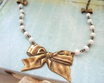 THE BOW NECKLACE, antique brass bow stamping necklace with milky white vintage beaded chain