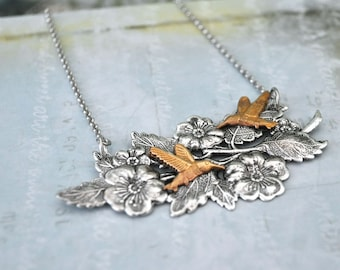 HUMMING BIRD and flower necklace in antique silver and brass