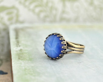 NORTHERN STAR vintage blue star glass cab ring in antique brass
