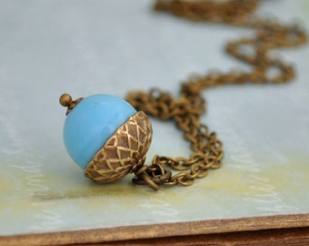 FIND Under the OAK TREE, antiqued brass acorn necklace with vintage blue glass beads