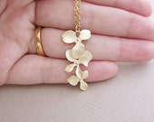 Beautiful Orchid Trio . Matte gold plated triple orchid charm Necklace