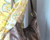 Dark brown Needle punch leather  tote.