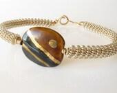 Silver coil bracelet Kazuri bead brown gold ethnic handmade
