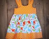 Reserved for BridalBijou Girl Dinosaur with Orange and white polka dot trim Dress