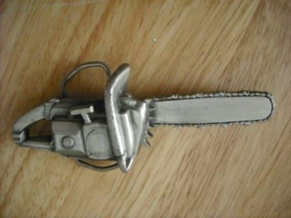 Vintage 1978 Bergamot BrassWork Chainsaw belt buckle, way cool