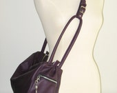 Purple tote with adjustable strap