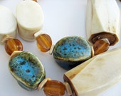 Bold African ivory with turquoise brown speckled ceramic and amber colored beads