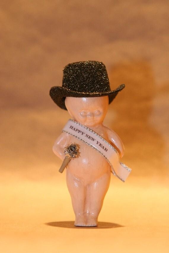 Chalkware baby new year figurine from vintage kewpie doll