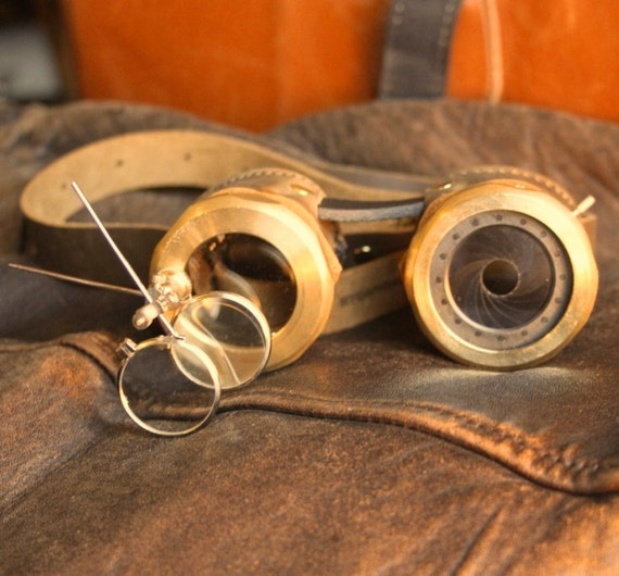 IRIS APERTURE goggles Brown and brass with one iris (left) and magnifier stem (right)