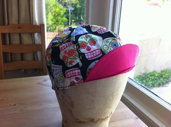 Reversible sugar skull print cycling cotton cap.