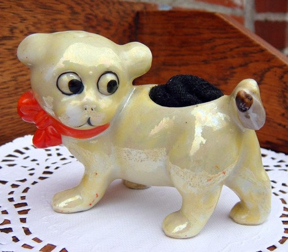 Charming Porcelain Pup Stares Down a Beetle on His Tail