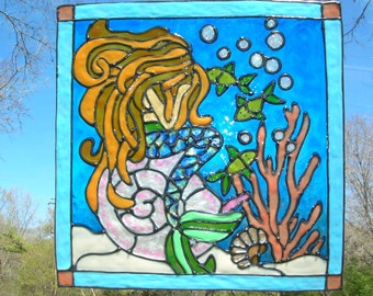 Mermaid weeping in ocean with fish and seashells stained glass window cling