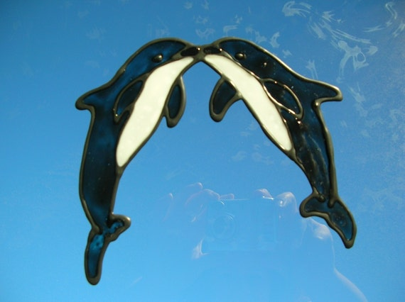 dolphins kissing stained glass window cling