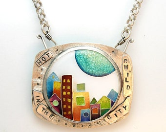 Enamel cloisonne textured silver pendant with stamped words and colorful cityscape