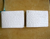 Embossed Tags/business card Holders