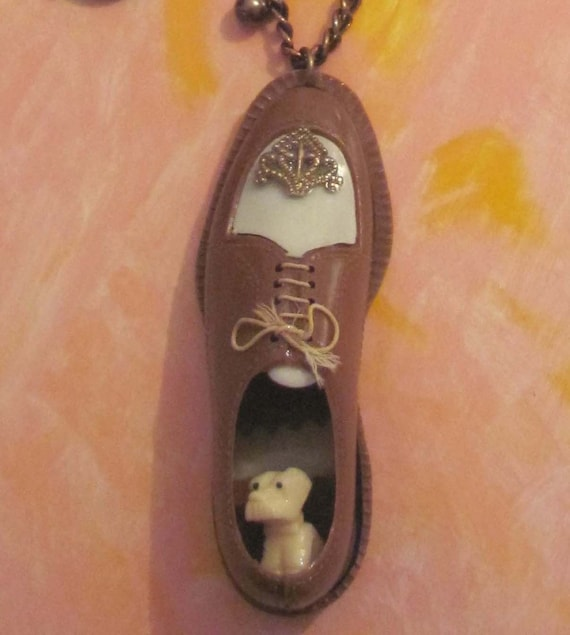 Dog Figure In Vintage toy shoe necklace with mini dog inside
