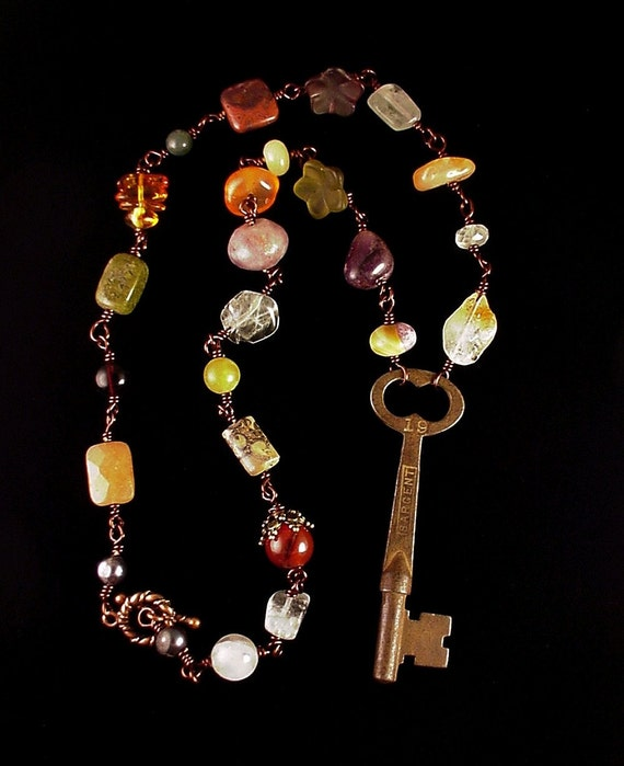 Antique Bohemian key necklace with gemstones warm natural earth tones
