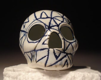 Triangle Tooth Cobalt Carvings Skull