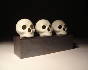 Three Gloss White Skulls With Slab Built Stoneware Stand Sculpture