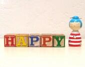 happy - vintage wooden letter blocks