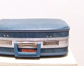 vintage blue suitcase with mirror