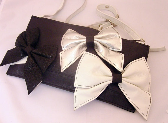 Marvelous Monday/ Black, white and silver leather handbag with a trio of bows.