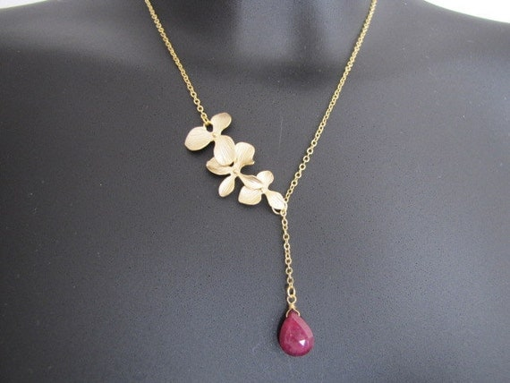 Flowers cascade and ruby lariat in gold (N144)