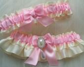 Ivory and light pink satin garter set