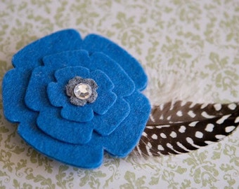 Blue felt flower w/feathers hair clip