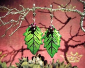 Holly berry garnet and sterling silver real holly leaf earrings.  Shipping included.