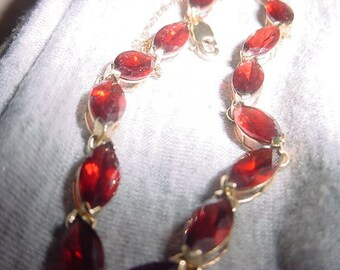 Graduation or Fourth of July  Day special- Red Mozambique Marquise Garnets set in 14 kt yellow gold   bracelet item#105516