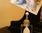 Letter Holder on Glass Bottle Embellished with Carved Bone
