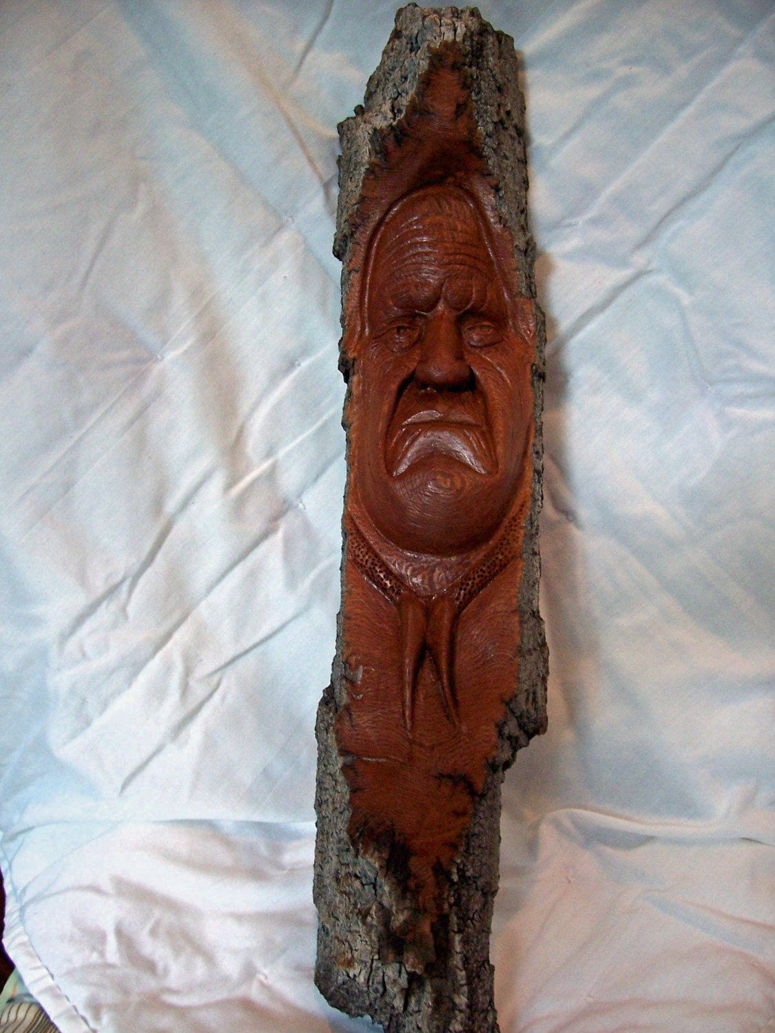 Hand carved native american on cottonwood bark