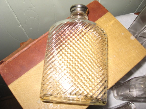 Universal glass flask bottle dated 1927