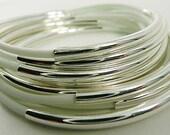 Sleek and Stylish White Rubber Bracelets