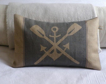 Rustic hand printed anchor and oars cushion in new England blues