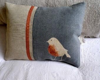 hand printed muted blue robin cushion