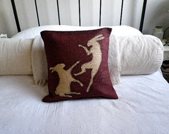 Limited edition burgundy boxing hares cushion cover