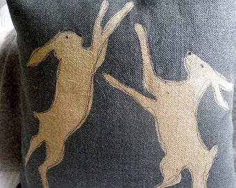 hand printed blues boxing hares cushion cover